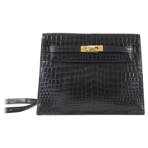 Guaranteed authentic urban legend Limited Edition HERMES Kelly Danse bag in matte Black Crocodile with...