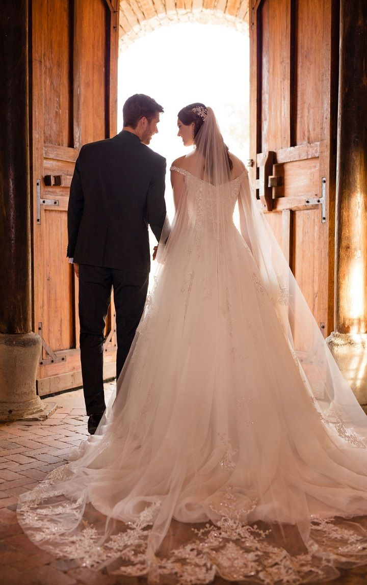 Off the shoulder princess wedding gown - shimmering off-the-shoulder sweetheart neckline, to a twinkling, full tulle skirt.