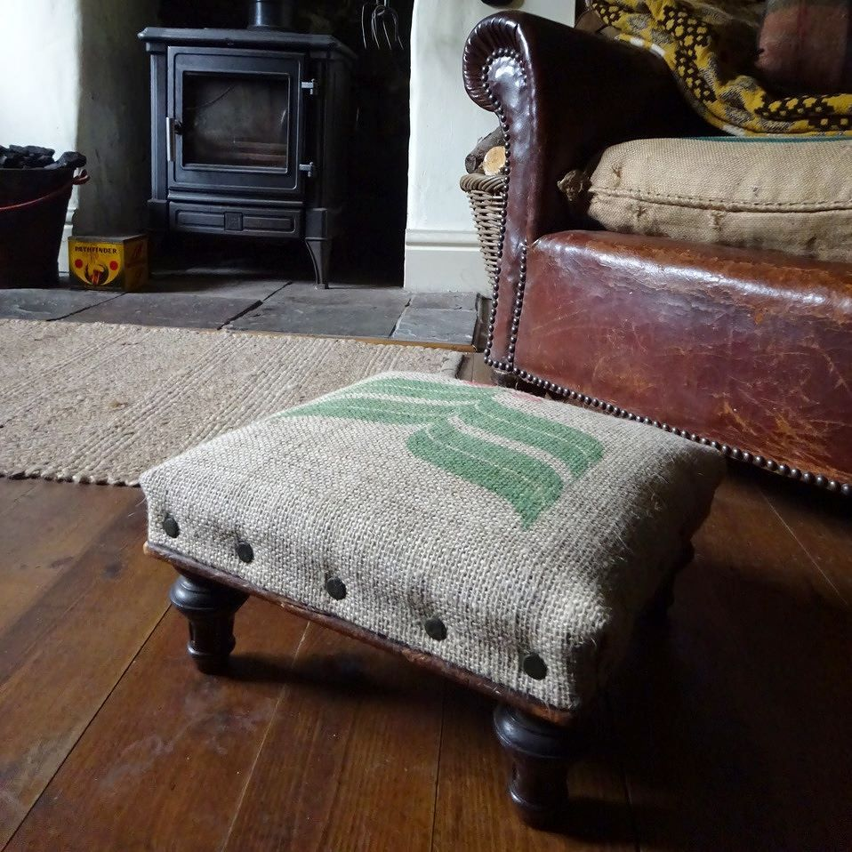 Justin brought this little footstool home today and I spent an hour removing its old threadbare cover and recovering it with a piece of a vintage coffee sack. It's just the perfect height for me to use whilst sitting in that leather club chair. @eclecticchairupholstery would be proud of my efforts!   #tuesdayvintagetreasure #hisforhome #vintage #homewares #vintagelove #vintagestyle #myvintagecollection #interiors #interiordecoration #instainterior #decor #myhome #ourhome #bloggershomes…