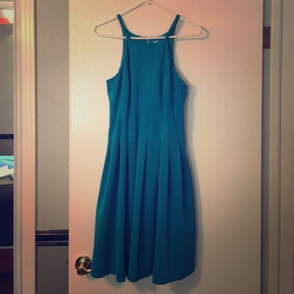 NWT Calvin Klein dress in an aqua blue!!! New With Tags Calvin Klein dress, size 6, very forgiving material and design. Beautiful pleats all the way down the dress with POCKETS!! Such a great dress for any occasion. Can't describe how comfortable it is!:) Calvin Klein Dresses
