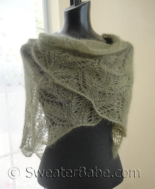 Is it a lace shawl or scarf? Either, depending on how you choose to wear it that day. What is not in question is how much you will love this wisp of an accessory! The mohair and silk lace weight yarn is supremely soft to knit with and a pleasure to wear against the skin.This shawl actually starts at the top center, with 3 sets of eyelet increases that cause the stitches to fan out into a semi-circular shape. The two side eyelet increase sets are then shifted to the edges when the lace…