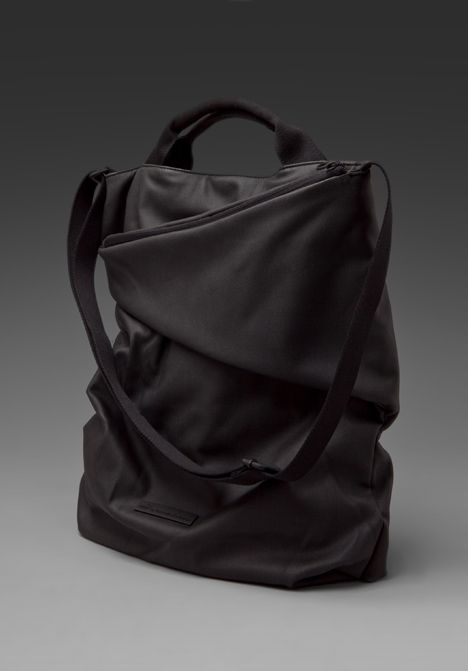 Puma Urban Mobility by Hussein Chalayan Downtown Shoulder Bag in Black from Revolve.com