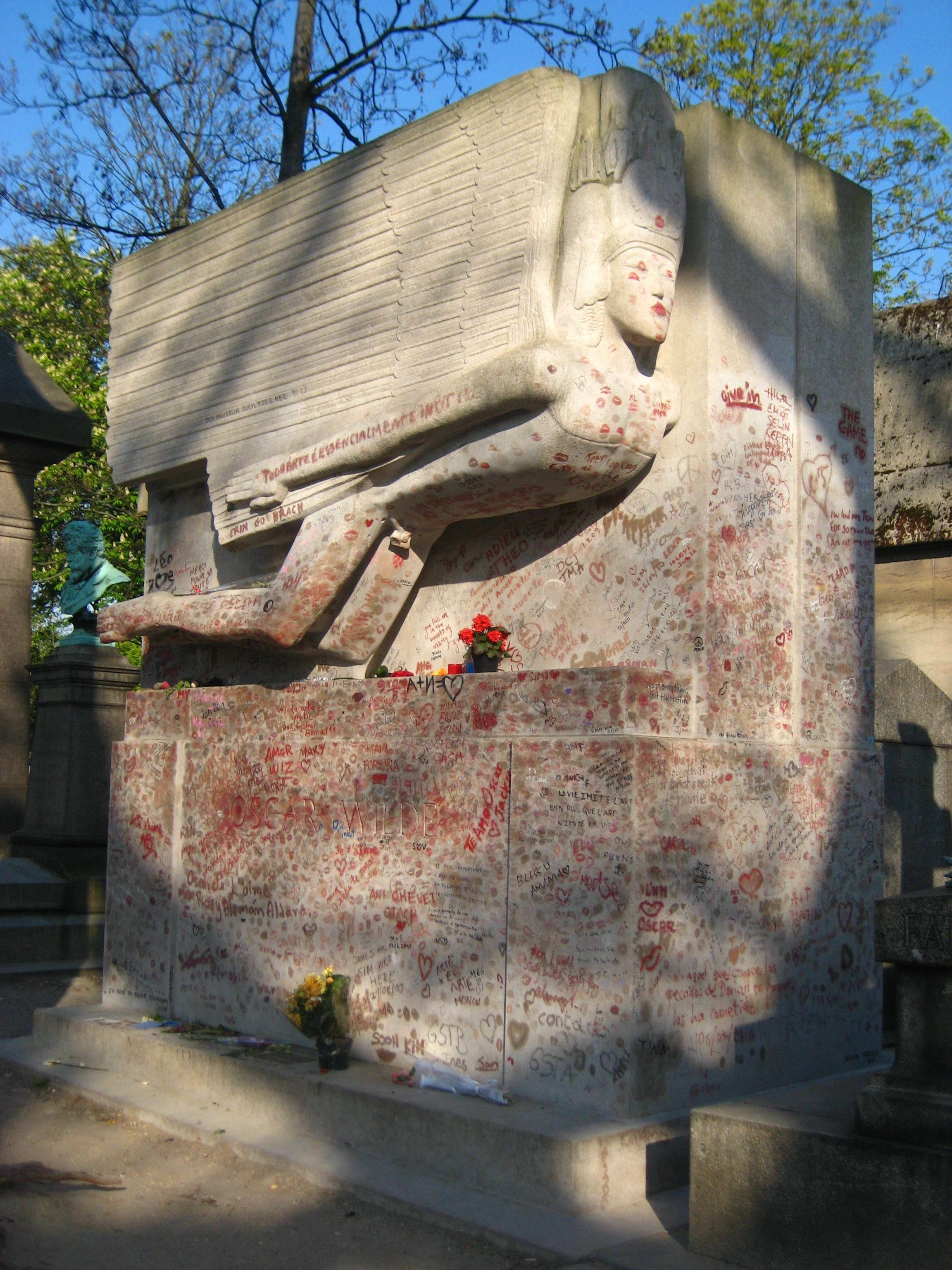 """Oscar Wilde's tomb in Paris. Recently, steps have been taken to stop folks from kissing (or, as some would say, """"defacing"""") the stone. I personally think it's sweet. It's nice to know you're loved, even if you've moved on."""