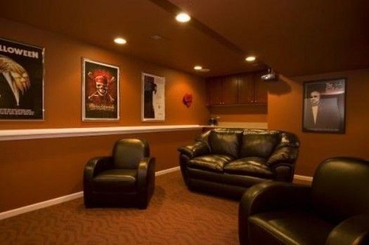 Love the idea of decorating with movie posters of favorite flicks in the Basement! Wouldn't go with this color though....