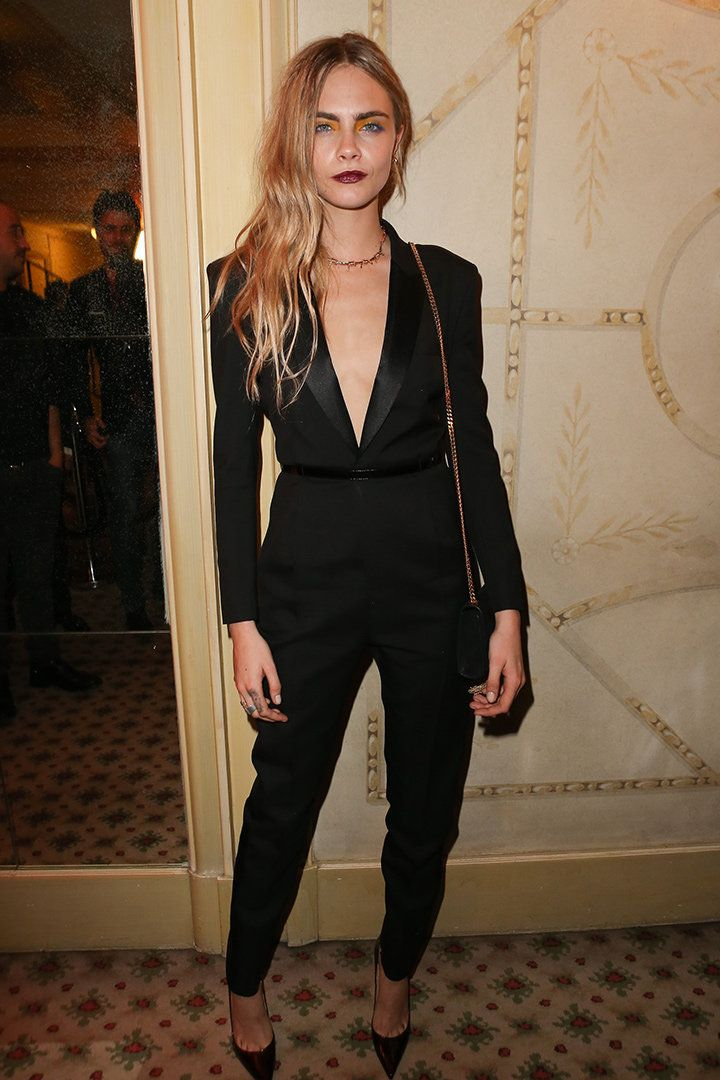 Cara Delevingne at Mademoiselle C cocktail party in Paris, wearing the tuxedo jumpsuit of Saint Laurent's last collection!