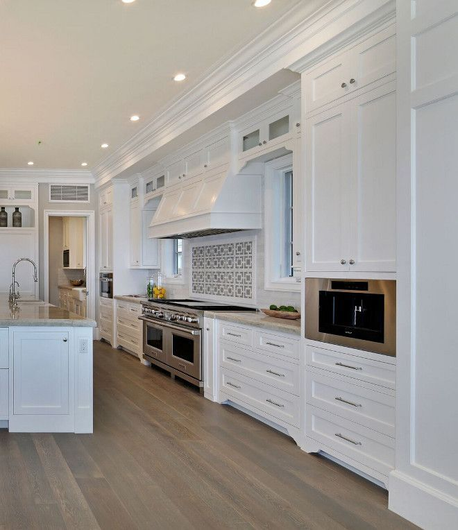Shaker Style Cabinet The Kitchen Features Shaker Style Cabinet With Beaded Face Fra White Shaker Kitchen Kitchen Cabinet Remodel White Shaker Kitchen Cabinets
