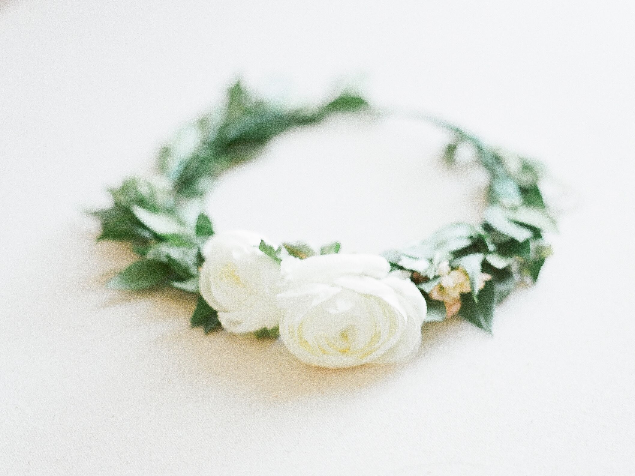 Petite Floral Crown With Simple White Ranunculus Flowers And Greenery For A Sweet Flowergirl Or A Minimali Ranunculus Flowers White Ranunculus Minimalist Bride