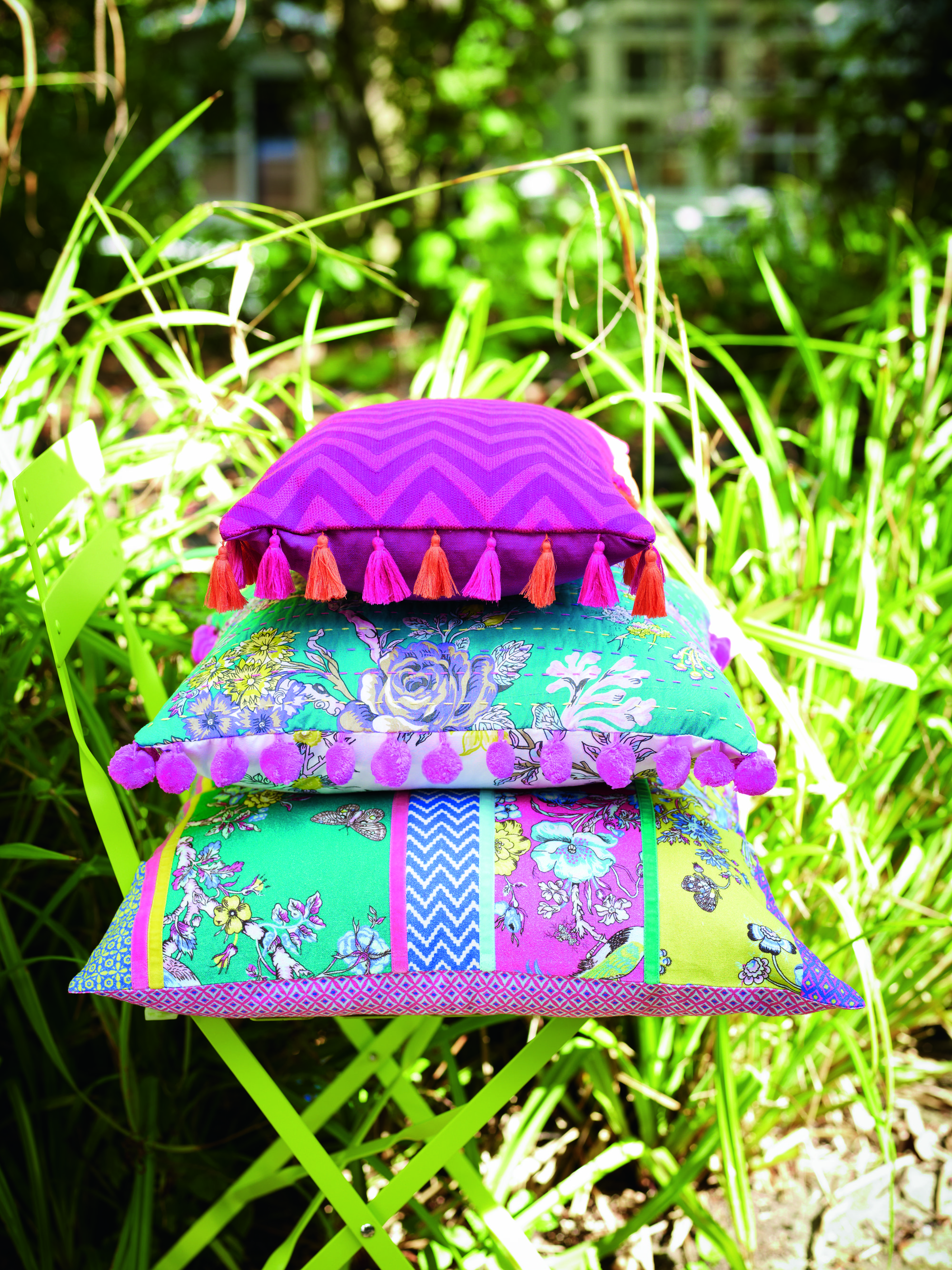 Bright green and pink cushions with tassels and patterns. #home #accessories #designer