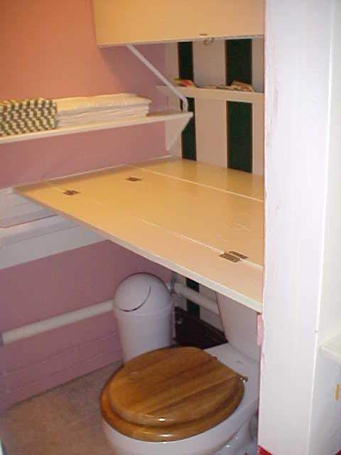 Perfect Changing Table That Folds Up Over Toilet...genius