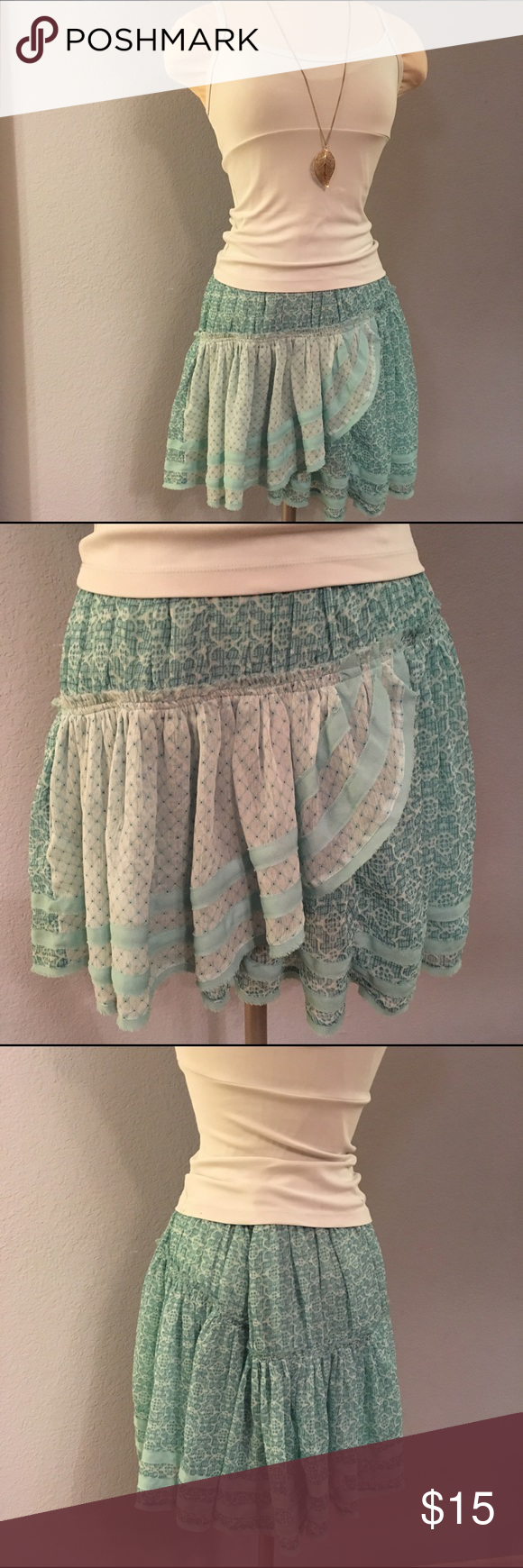 """Free People Skirt Size 6 This is a pretty Tiffany blue colored Free People skirt in size 6 (approx 14"""" waist/16-17"""" in length). It zips and clasps at side of waist and is fully lined underneath. In good condition, no flaws. *this is for the skirt only Free People Skirts Midi"""