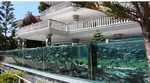 An Engineer And Businessman In The Coastal Town Of Cesme, Turkey, Put A  Huge Aquarium Outside His House In Place Of A Garden Wall.