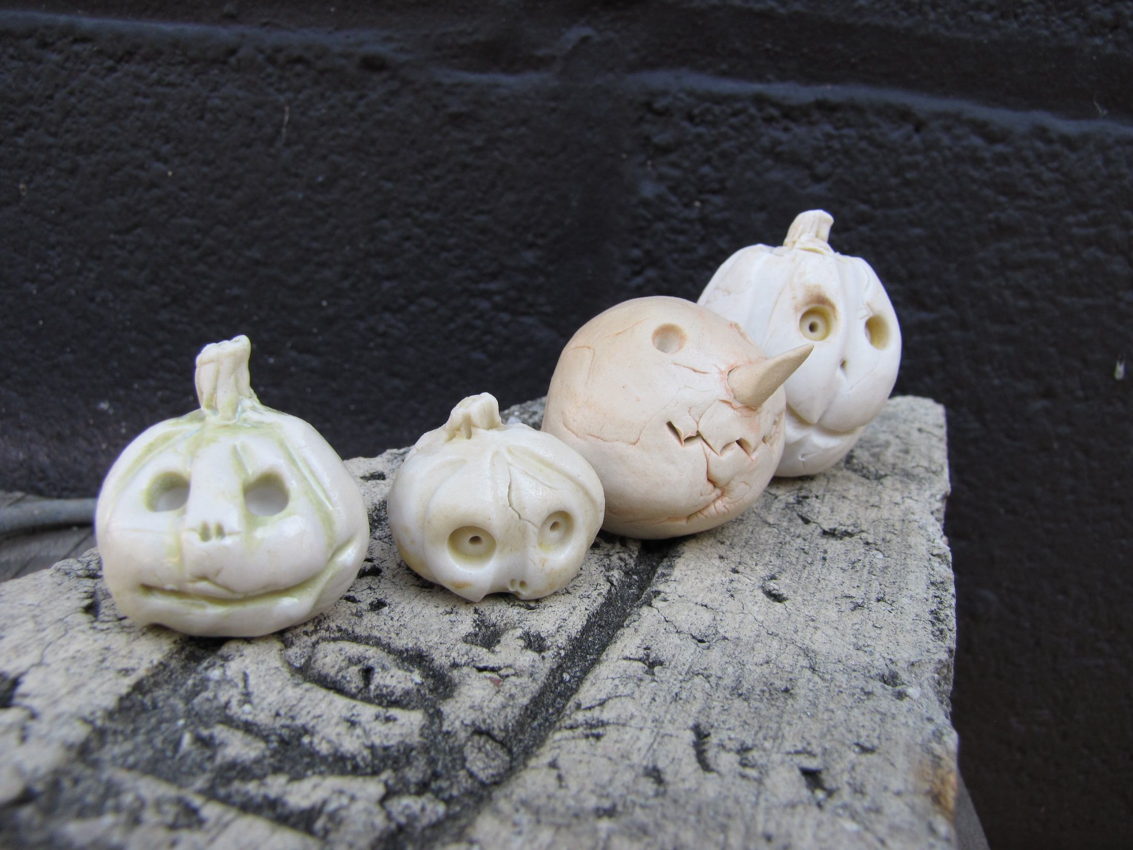 Little tiny pumpkin set by Oxide Pottery. Porcelain and underglaze- fired to cone 6 in an electric kiln.