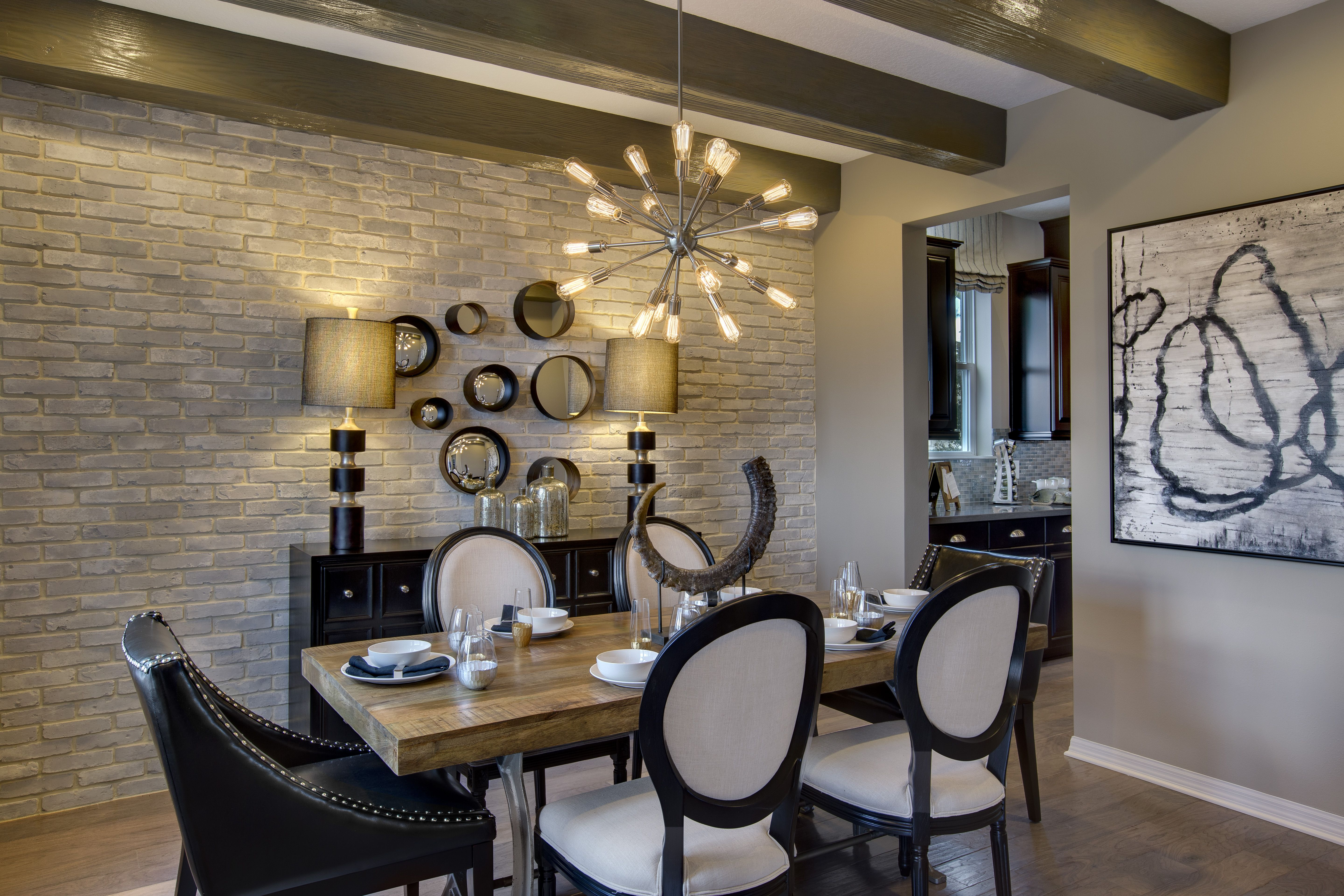 industrial style dining room with brick wall wood floors faux