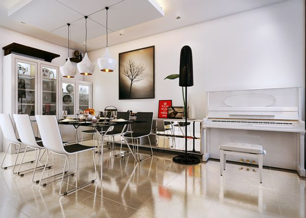 An upright vintage piano adds a fun element to the rather serious modern  decor in the dining room An upright vintage piano adds a fun element to the rather serious  . Piano Dining Room Table. Home Design Ideas