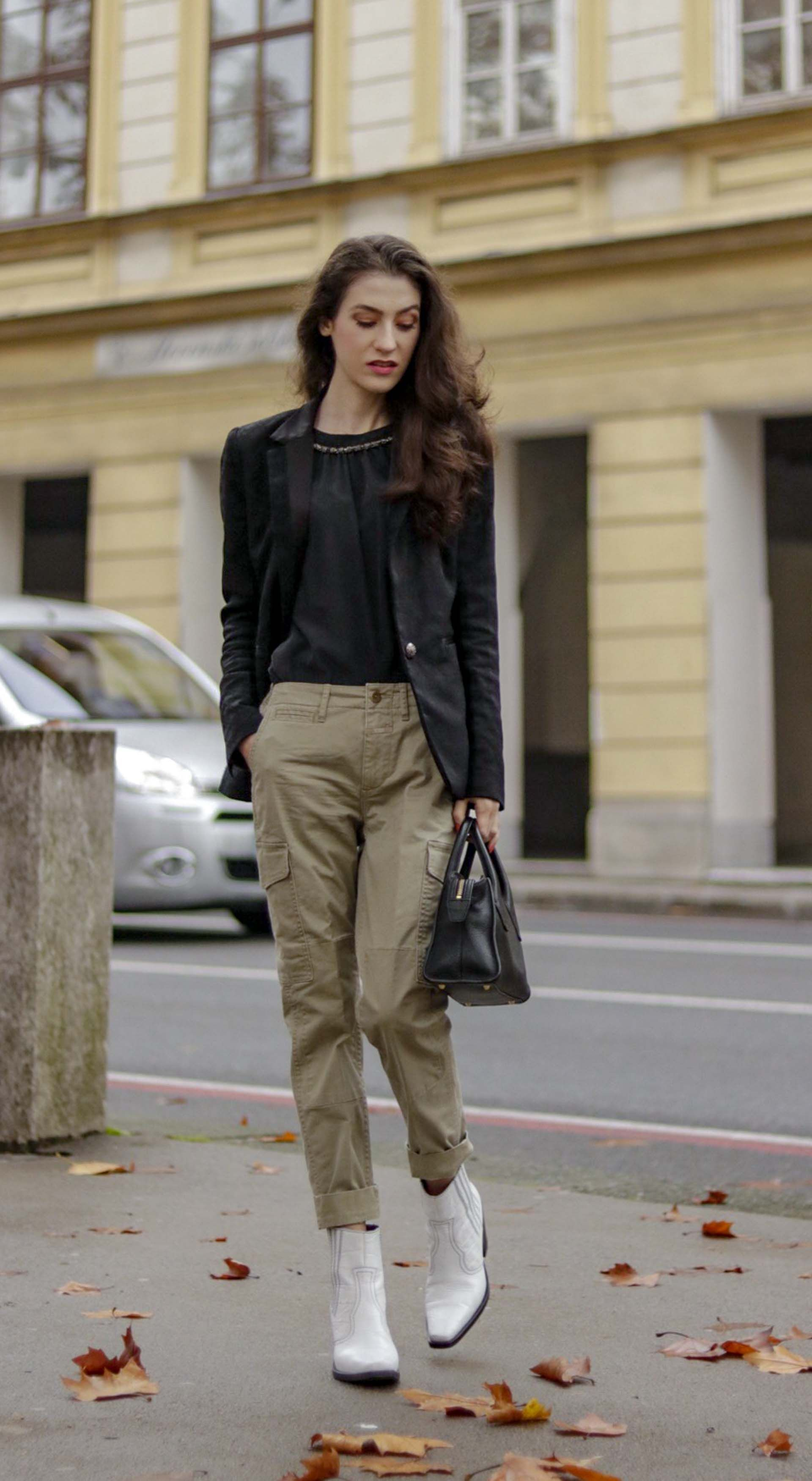 0f234423ab24 Fashion Blogger Veronika Lipar of Brunette from Wall Street showing how  Parisians wear cargo pants  fashion  blogpost  everydayoutfit  fashionable  ...