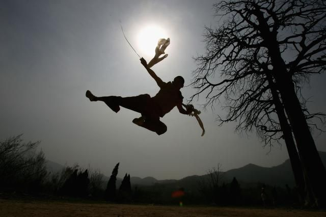 The Fighting Monks of Shaolin Temple: Silhouette of a Soaring Shaolin Monk