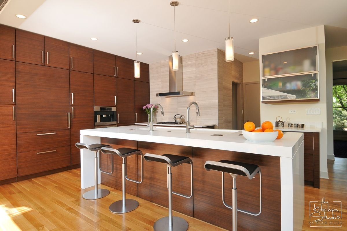 Modern kitchen with bamboo cabinets and white quartz ... on Modern Kitchen Countertop Decor  id=14462