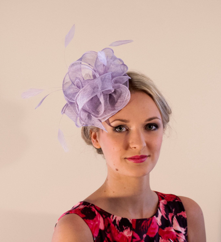 Purple feather fascinator hat