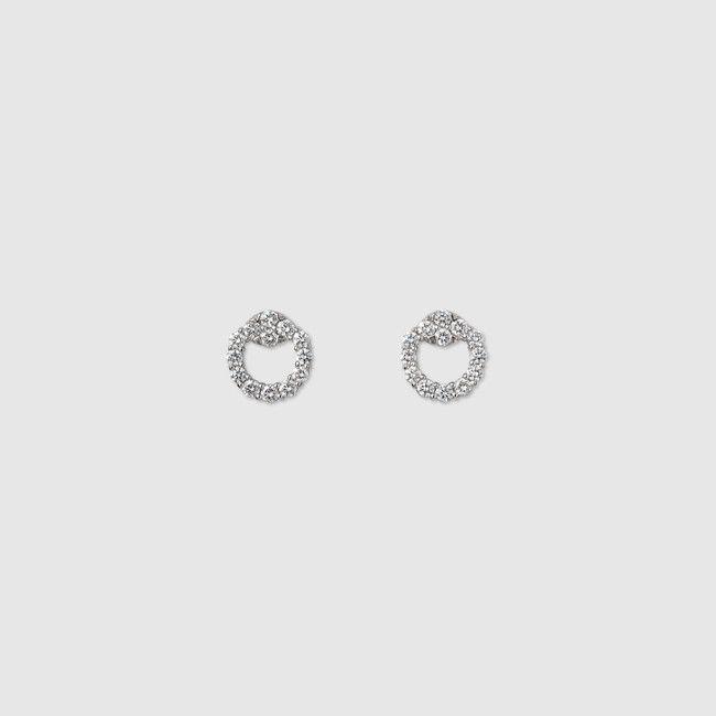 18k white gold horsebit earrings featuring pavé diamonds.
