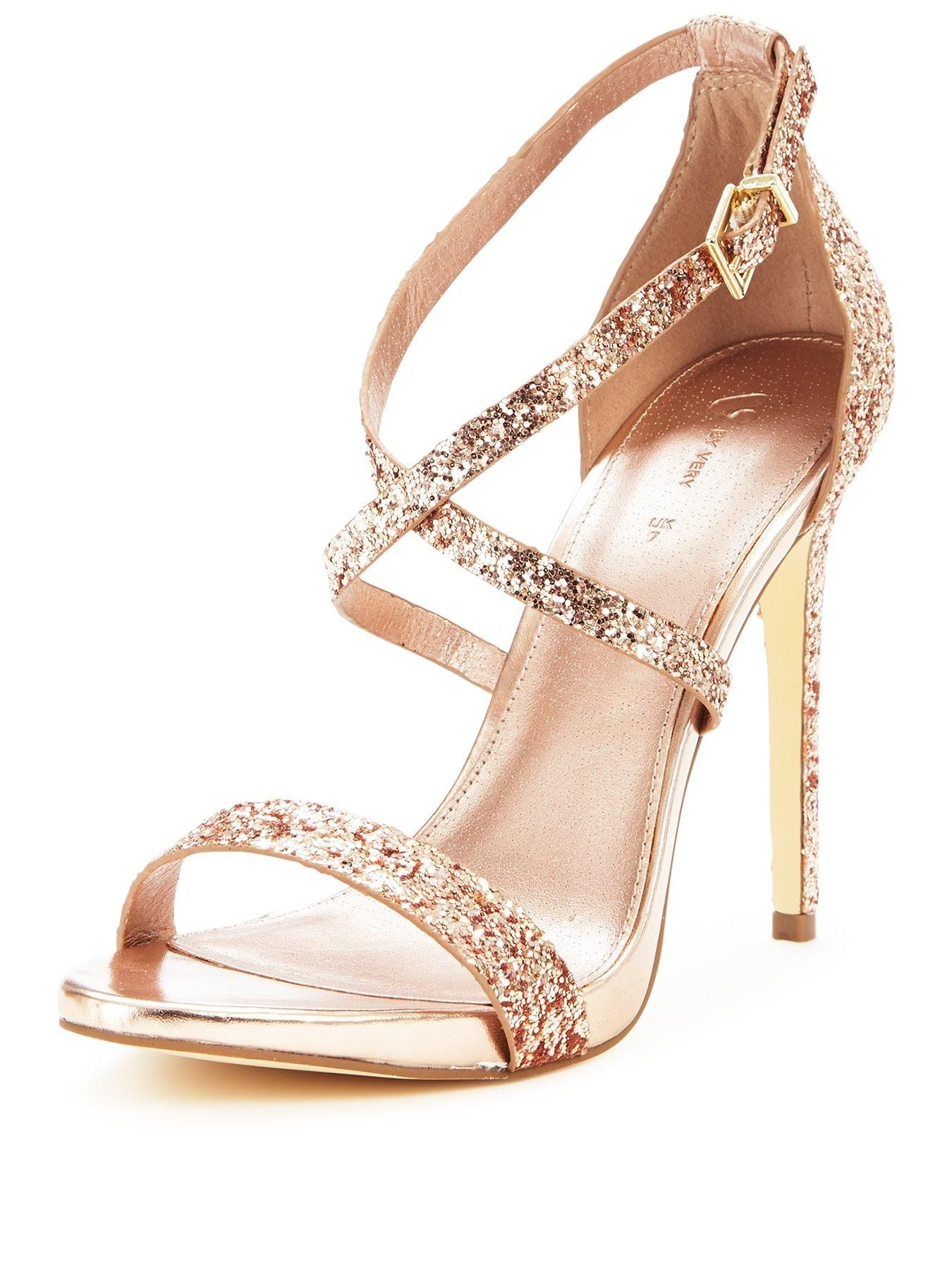V by Very Caprice Glitter Heeled Sandals - Rose Gold Gorgeously girly and super glam - these Caprice glitter heeled sandals from V by Very are a must for girls who want to turn heads! Covered top to toe in rose gold glitter and featuring a stomp-worthy stiletto heel, they create jaws-to-the-floor impact at any event! Styling Ideas Try matching your heels to your clutch for added polished points!