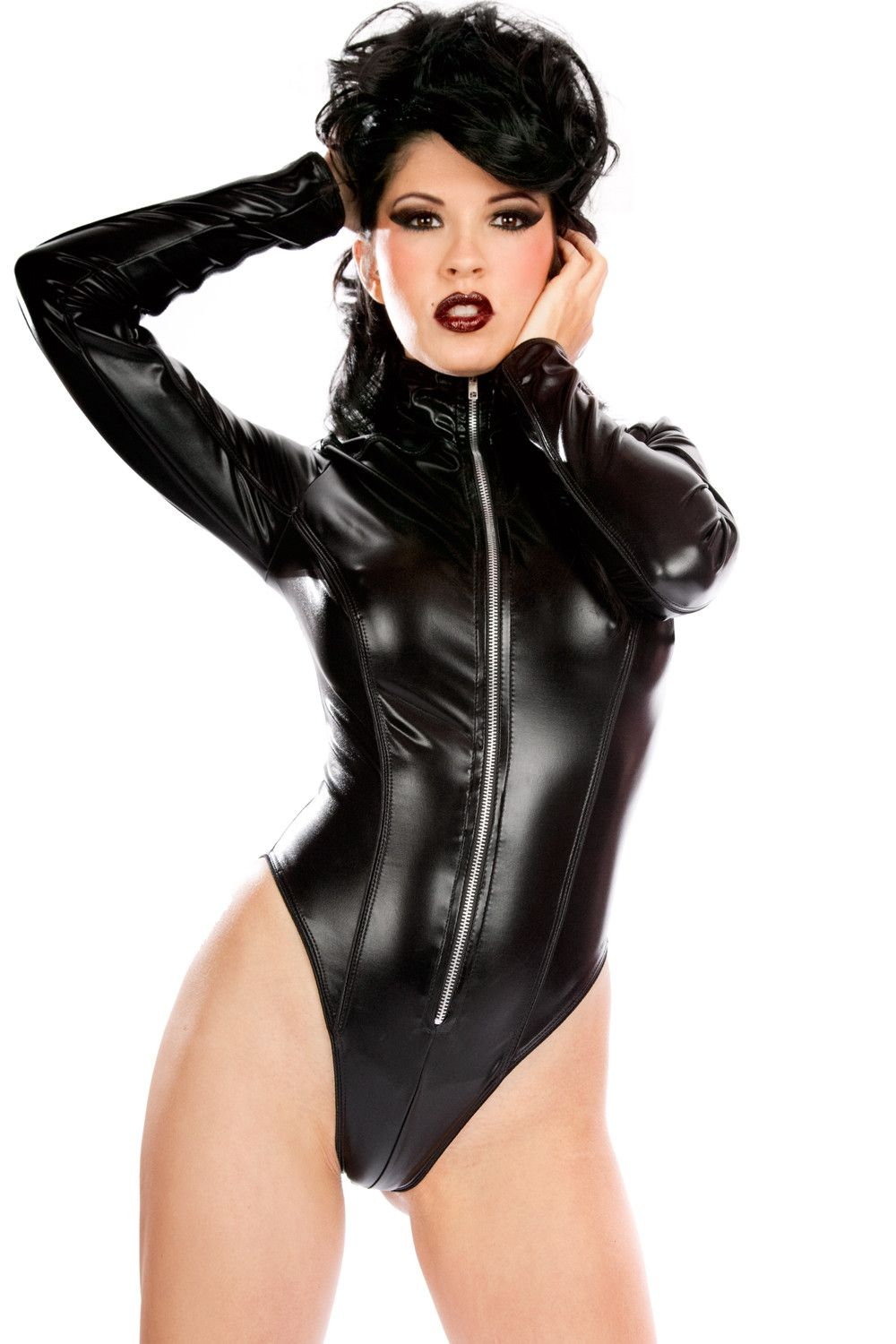 15eaf905c569 ... The Toxic High Collar Teddy is a long sleeved one-piece liquid metal  spandex creation with high cut sides, a high collar, and a zipper along the  front.