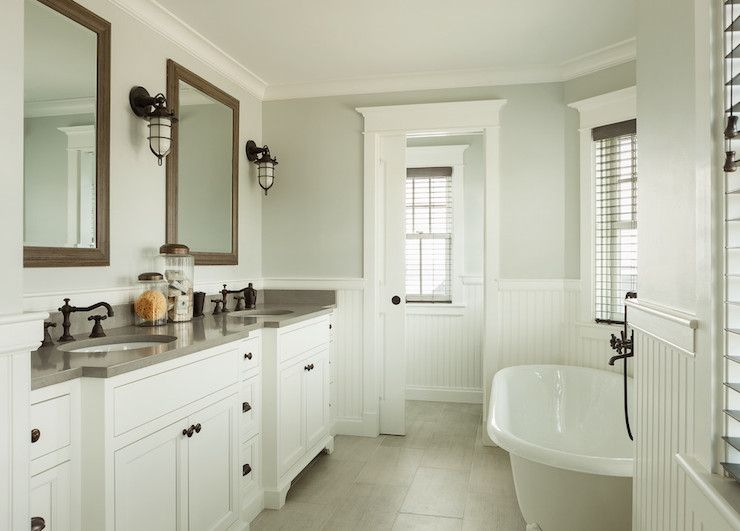 Dreamy ensuite bath features gray green paint and white - Bathroom remodel ideas with wainscoting ...