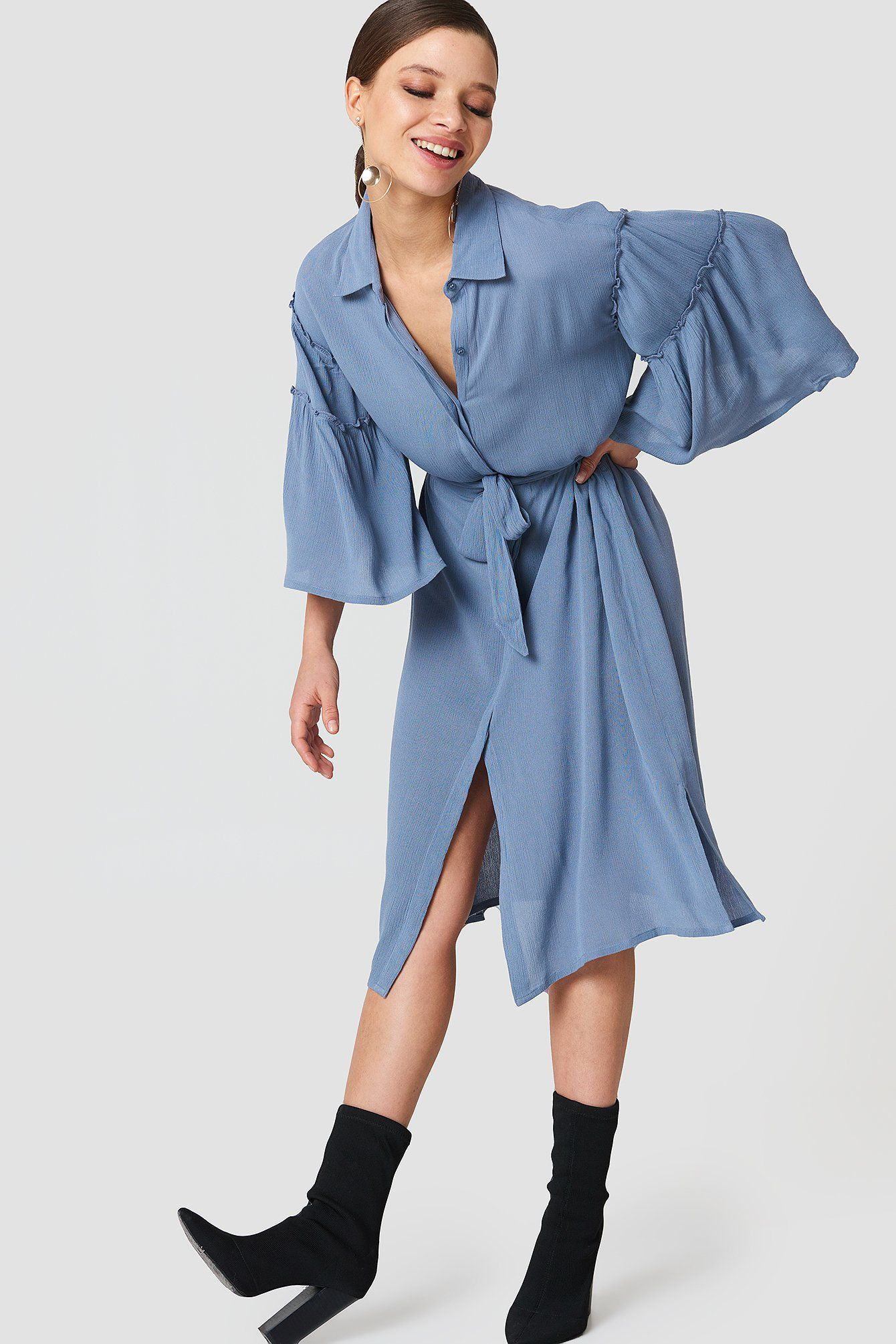 be0f4b406df5 The Flounce Sleeve Shirt Dress by NA-KD features a collared neckline ...