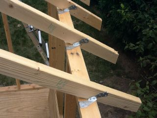Shed construction project framing rafters ucandoit for How to build a sloped roof shed