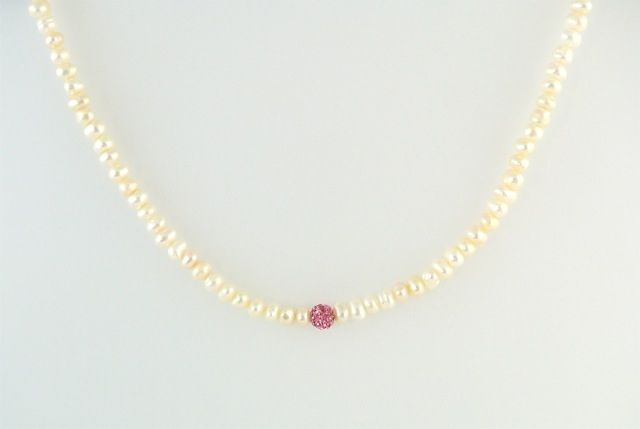 6633d6051 Strawberry Kiss Necklace: Button pearl strand with a sparkly pink accent.