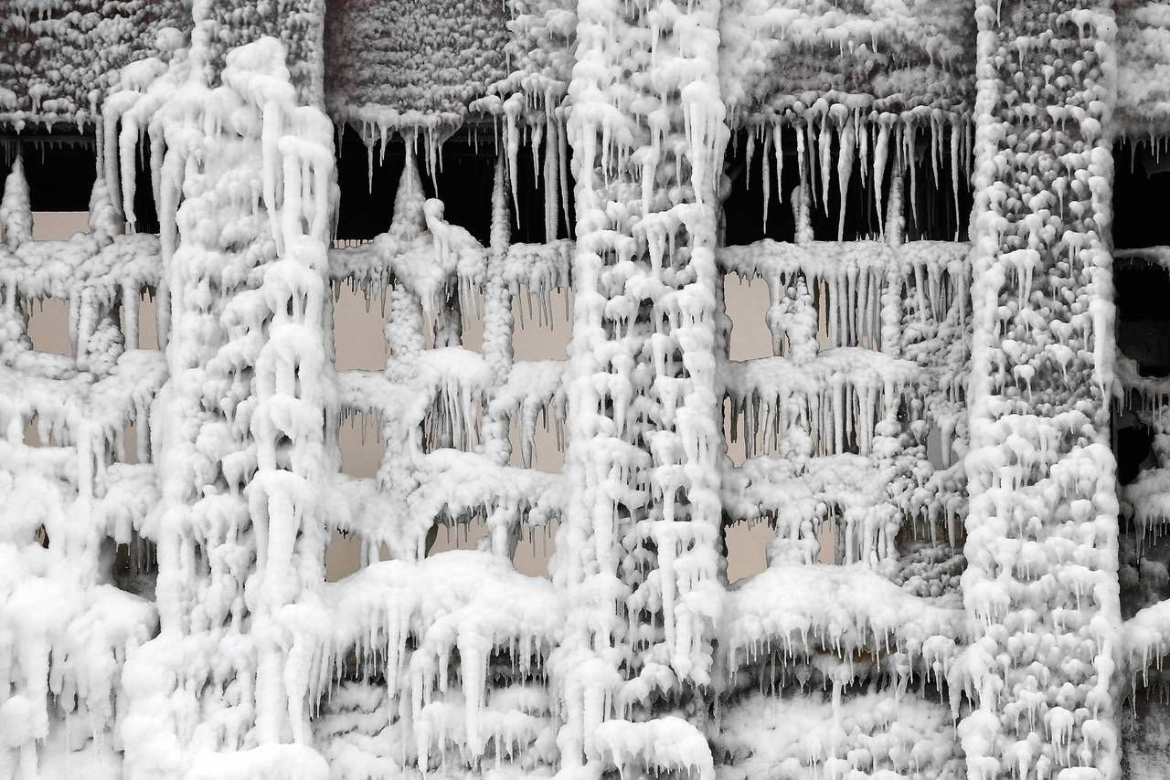 Fire and Ice - more here http://www.thisiscolossal.com/2013/01/fire-and-ice-the-frozen-aftermath-of-a-chicago-warehouse-fire/