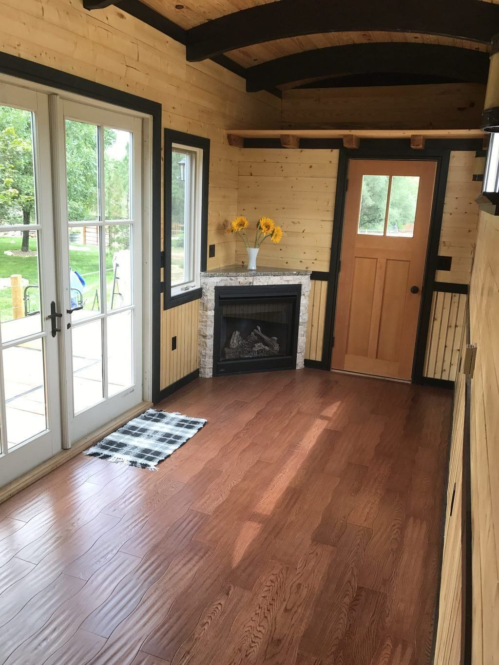 Over 400 square feet of of indoor living space with a 200 square foot fold down deck and 30 square foot back porch this house is packed with amenities