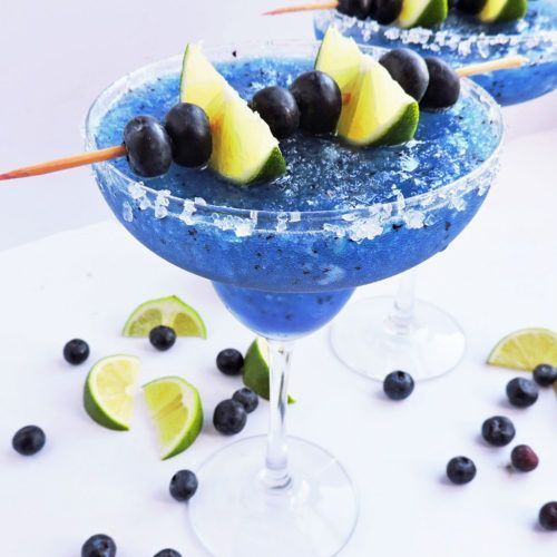 Fresh Frozen Blueberry Lime Margarita #limemargarita Fresh Frozen Blueberry Lime Margarita, blue margarita serve in a margarita glass with kosher salt around the rim, topped with lime wedges and blueberries #limemargarita Fresh Frozen Blueberry Lime Margarita #limemargarita Fresh Frozen Blueberry Lime Margarita, blue margarita serve in a margarita glass with kosher salt around the rim, topped with lime wedges and blueberries #limemargarita