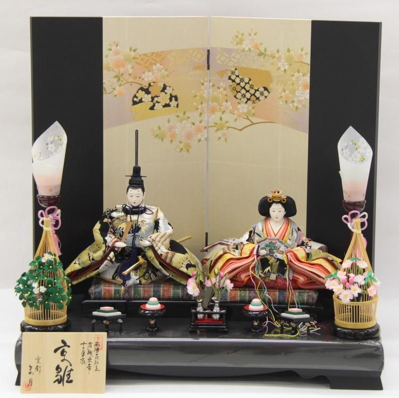 A hina doll set dressed in heian robes.