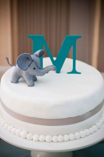 blue elephant baby naming party cake with monogram topper