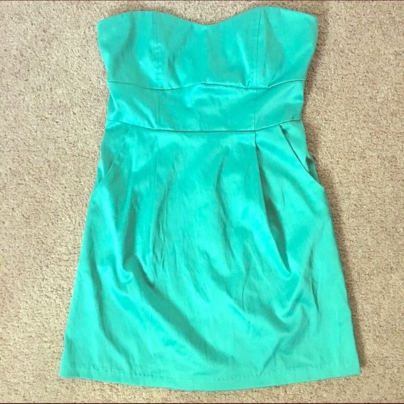 Green strapless dress size small This item has been worn before. Green strapless dress with zipper in the back size small. Material looks a little shiny. 92% Polyester 8% Spandex. Dresses Strapless