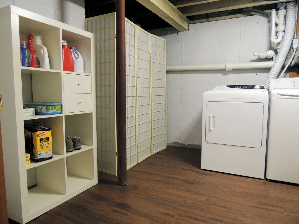 Hiding A Basement Water Heater Oil Tank Laundry Room Design Basement Laundry Room Basement Makeover