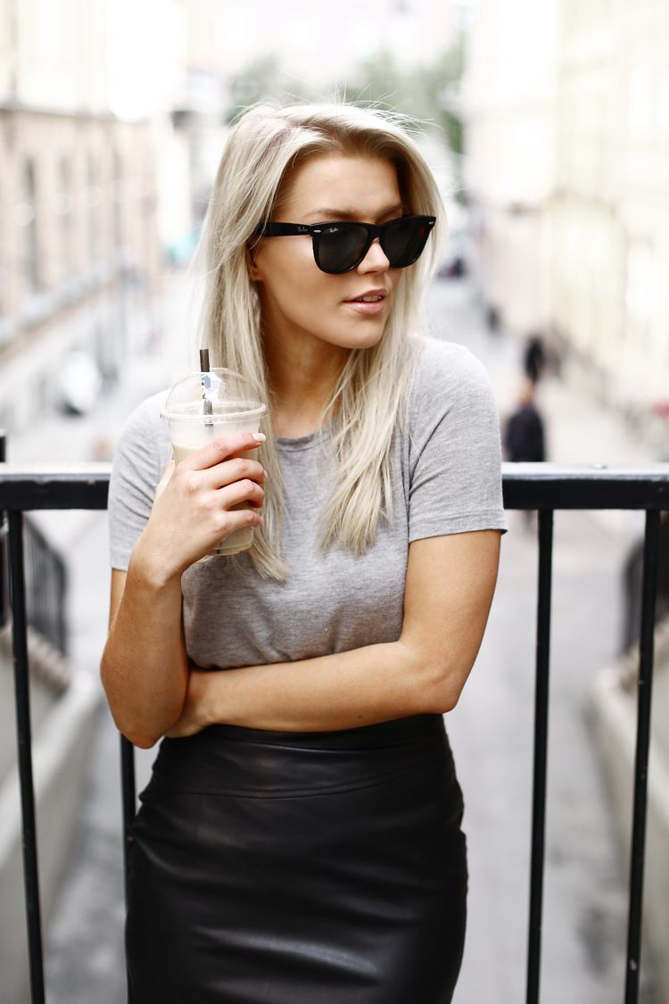 Linda Juhola in grey t-shirt, black NLY Trend skirt, Ray Ban sunglasses and white Adidas Sneakers