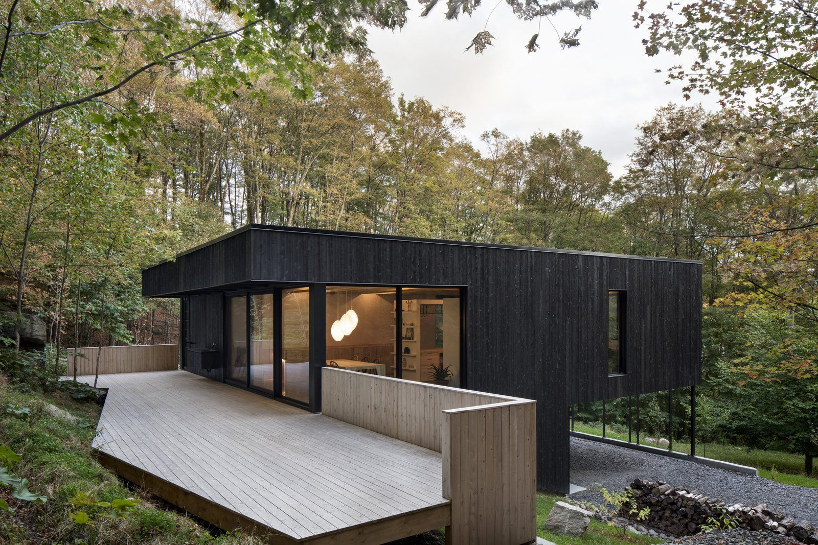 This Wood Clad Home Is Built Into A Serene Mountain Slope