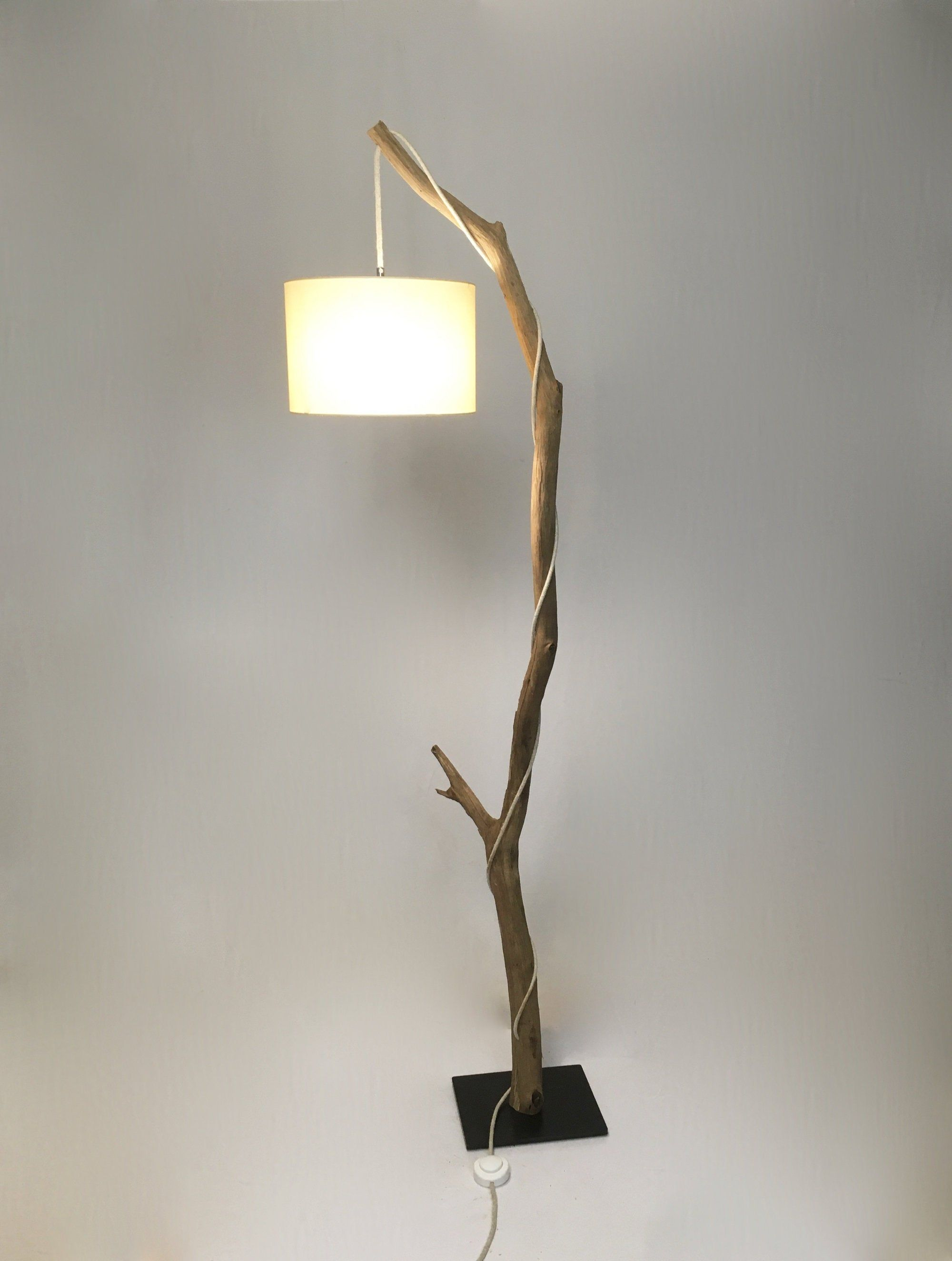 Weathered oak branch floor lamp cotton lampshade and jute cable.