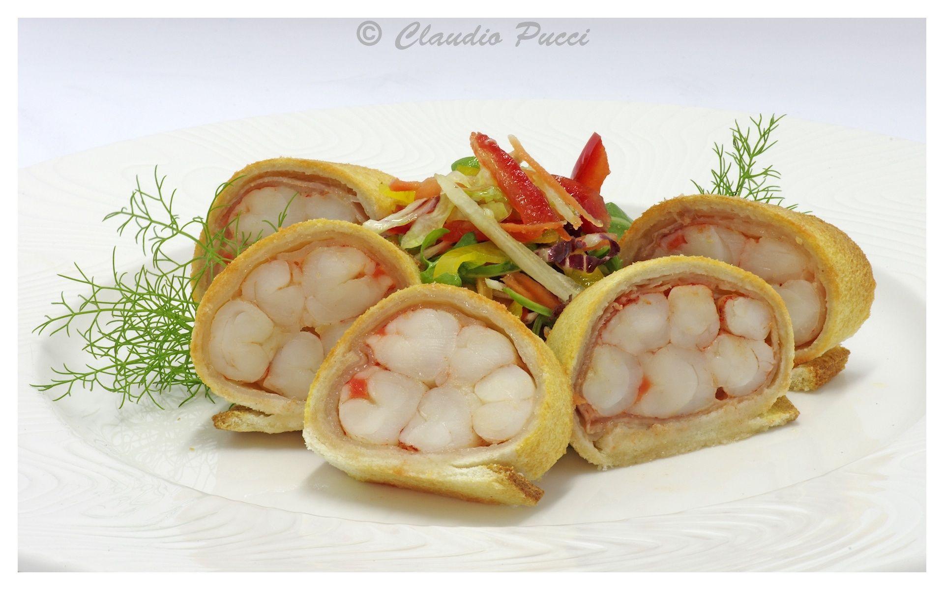Gamberoni in crosta di pane con lardo di colonnata .