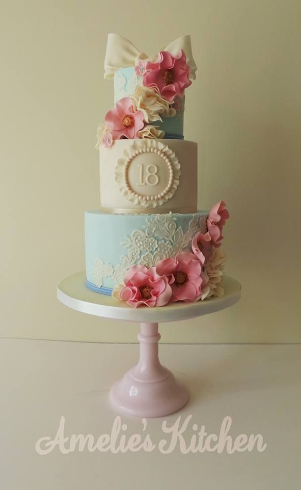 Vintage lace bows ruffles pearls and flowers cake like this idea
