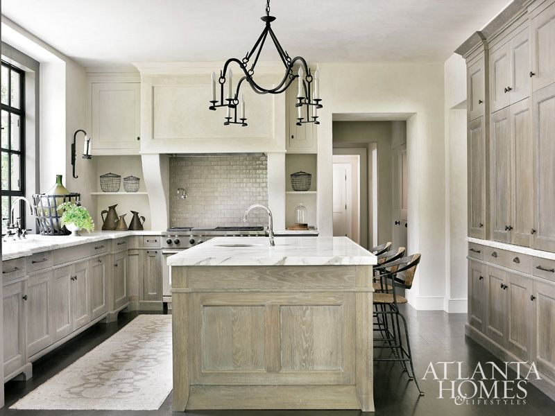 This kitchen, which is one of my favorites too, has 'washed grey oak  cabinetry by Block & Chisel . The counters are.