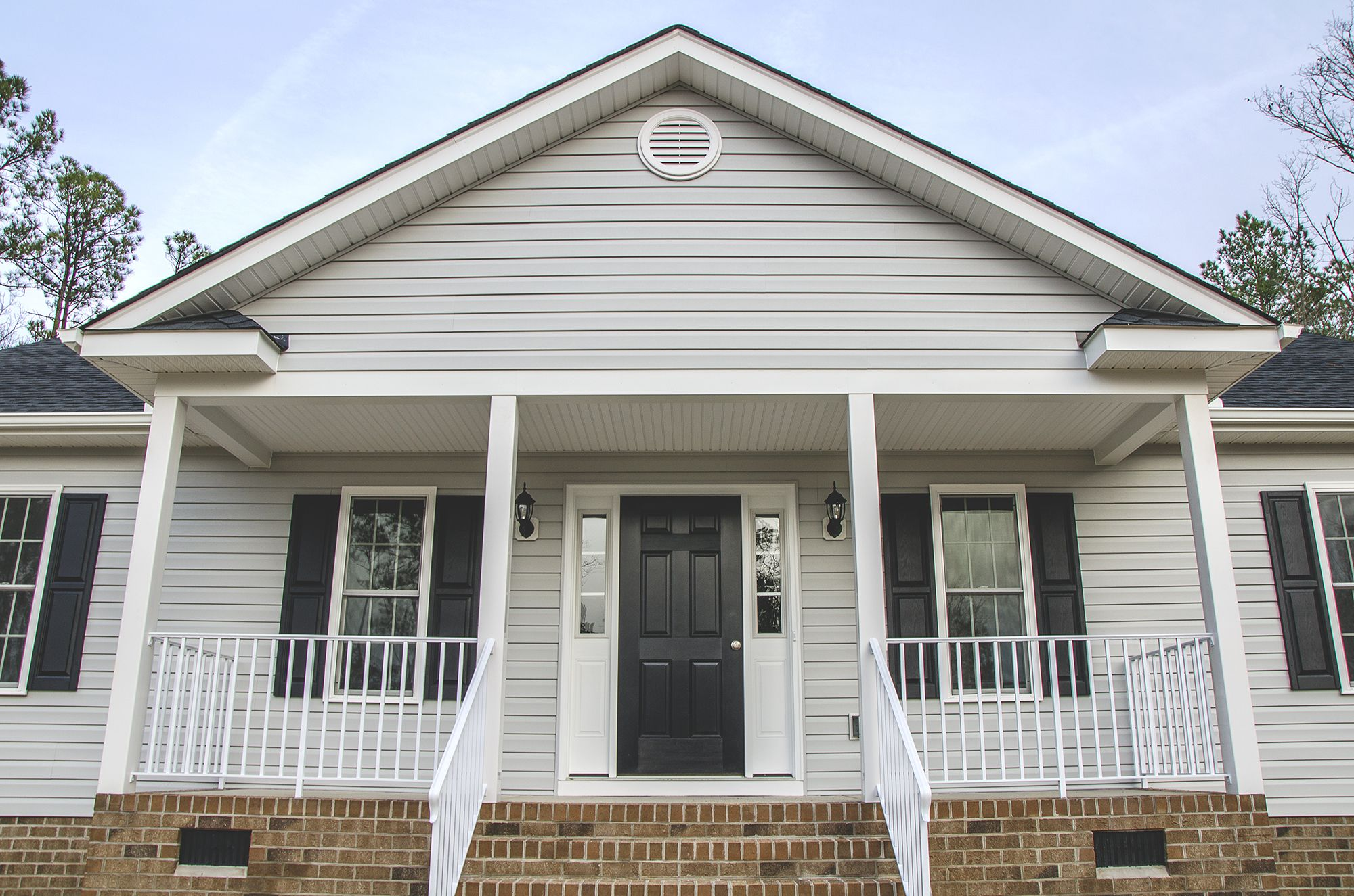 This Custom Home As Gray Vinyl Siding White Trim And Black Accents We Love The Spacious Front Porch C Balducc Custom Home Builders Custom Homes Home Builders