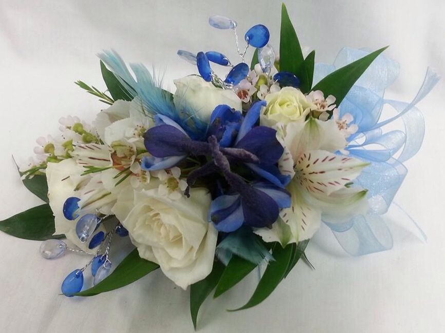 Royal blue and white corsage for homecoming. Made by countryside florist.