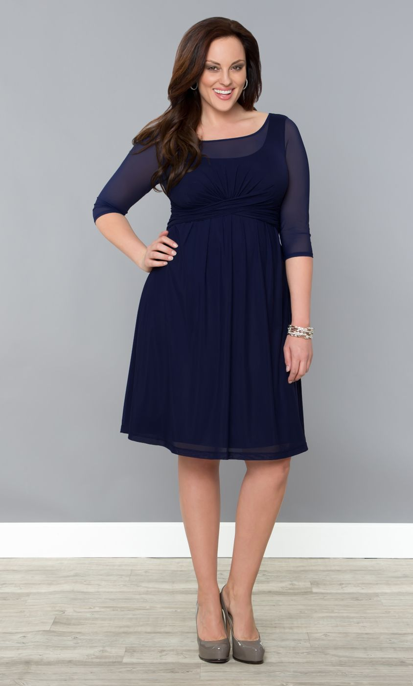 Our plus size Morgan Mesh Dress is made with a light and airy mesh that travels well with virtually no wrinkling.  The high mesh neckline and sleeves keep you covered and the fuller skirt adds shape.  #KiyonnaPlusYou #Kiyonna #Plussize