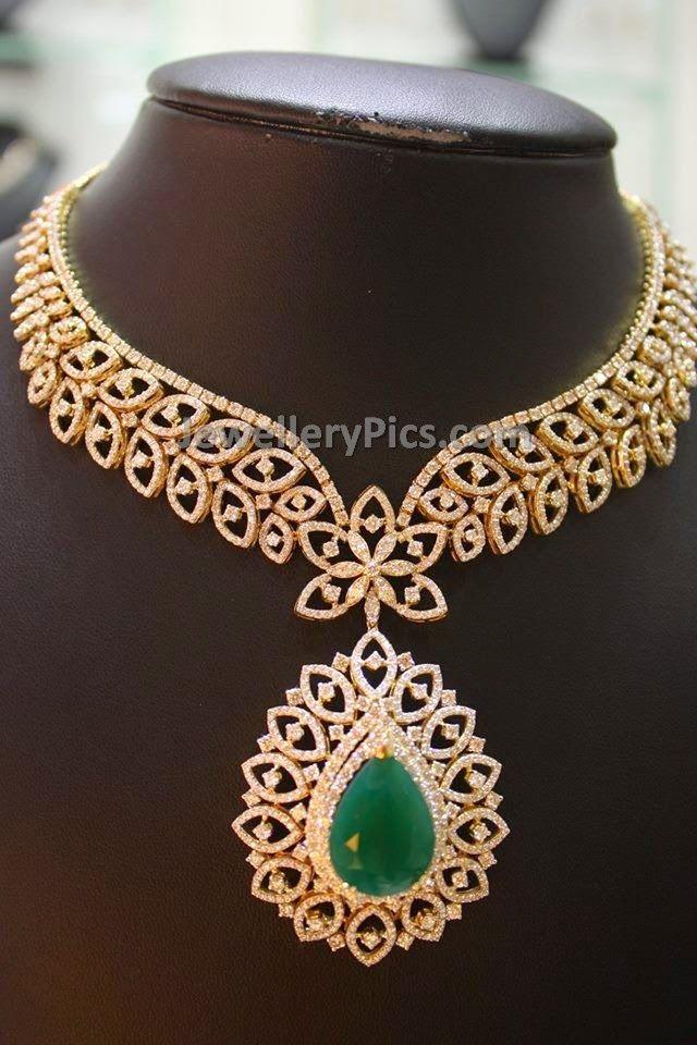 Diamond leaflet shaped necklace with big emerald pendant - Latest Jewellery Designs