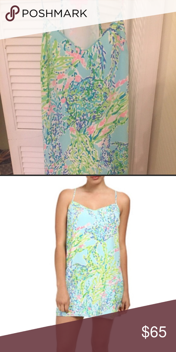 Lilly Pulitzer Dusk Dress Size XXS Dusk dress is Blue Heaven. Has been worn twice and dry cleaned, was a previous poshmark purchase so I can not speak to wear or cleaning  by the previous owner. First and last picture is of the actual dress for sale, front and back, back picture taken on 4/23. Please ask any questions prior to purchase. Lilly Pulitzer Dresses