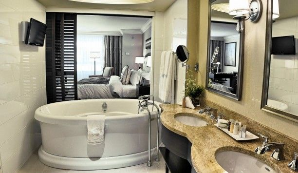 Le St-Martin Hotel & Suites: Bathrooms in Grand Luxe rooms have standalone tubs, sliding doors and even TVs.