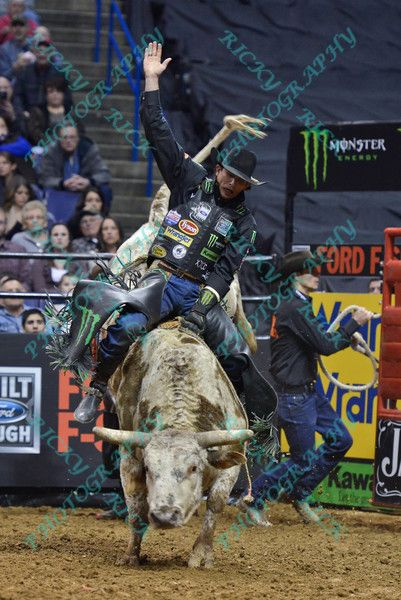 7b4c532201fd3 Rider J.B. MAUNEY on bull PISTOL PETE during the first round at the  Professional…