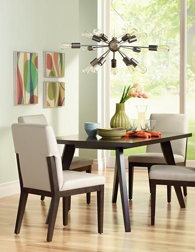 This Sleek Dining Room Features A Sputnik Style Chandelier Overhead